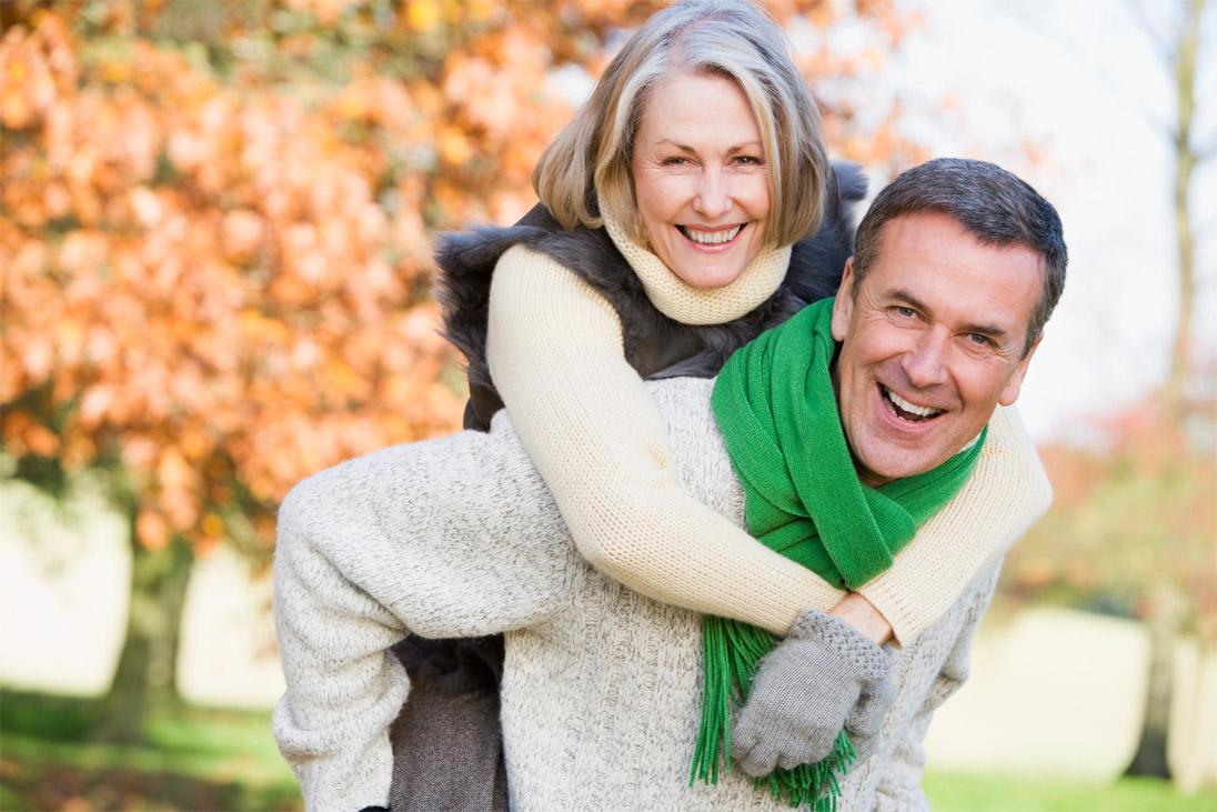 Senior Man Giving Woman Piggyback