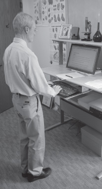 photograph of editor using stand-up desk