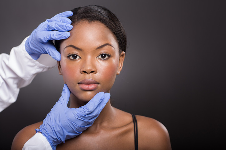dermatologist-examing-face-off-African-American-woman