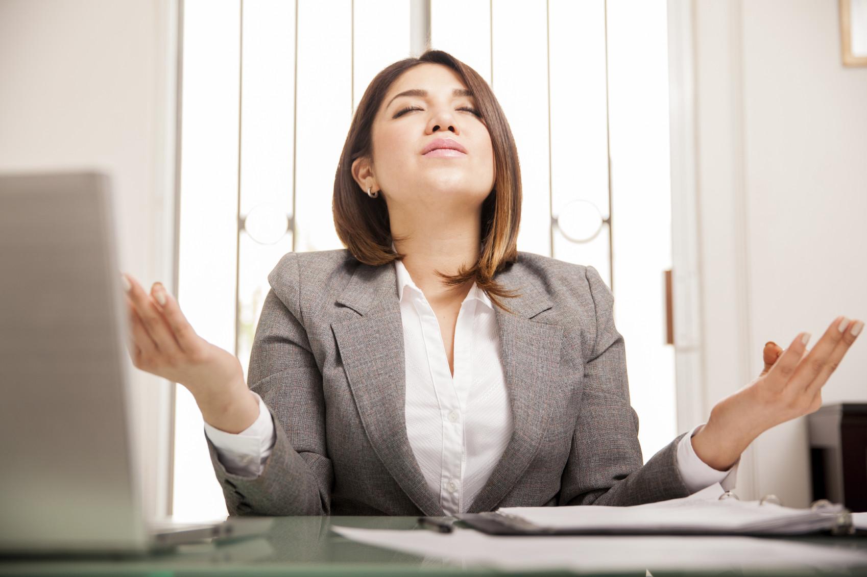 woman-meditating-at-work-mindful-moddiStock_000057640526_Medium