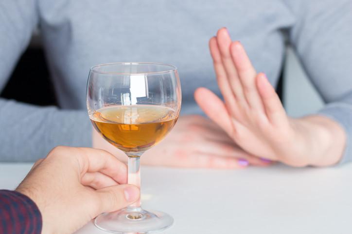 woman-declining-alcohol