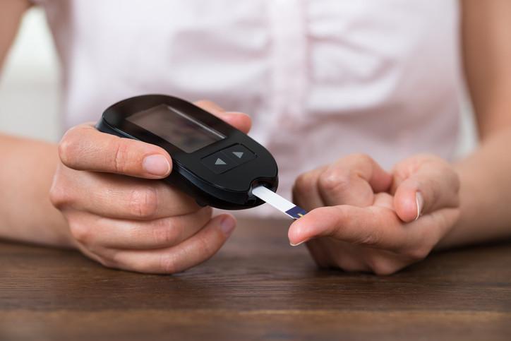 woman-checking-her-blood-sugar