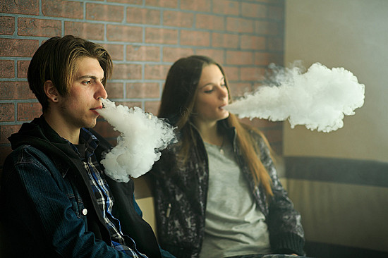 Blown up in smoke: Young adults who vape at greater risk of COVID symptoms featured image
