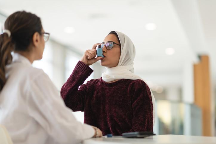 woman-using-asthma-inhaler