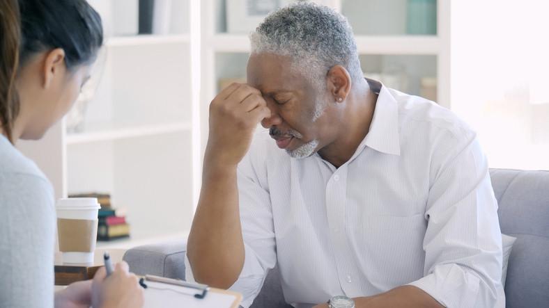 African-American-black-man-upset-in-doctor-office