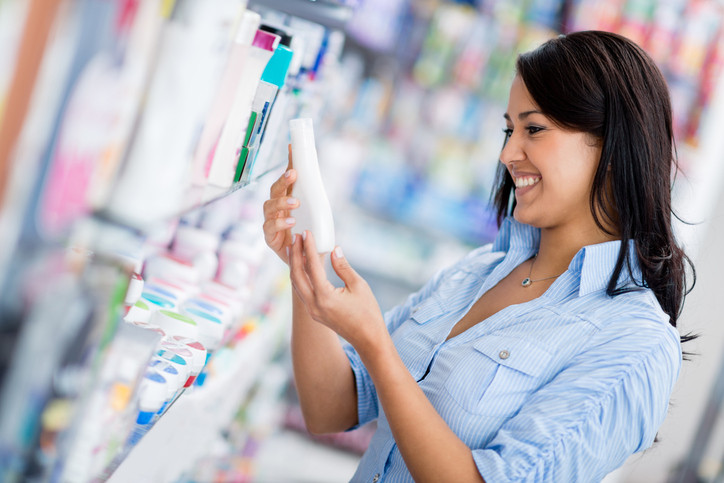 woman-shopping-for-lotion-in-drugstore