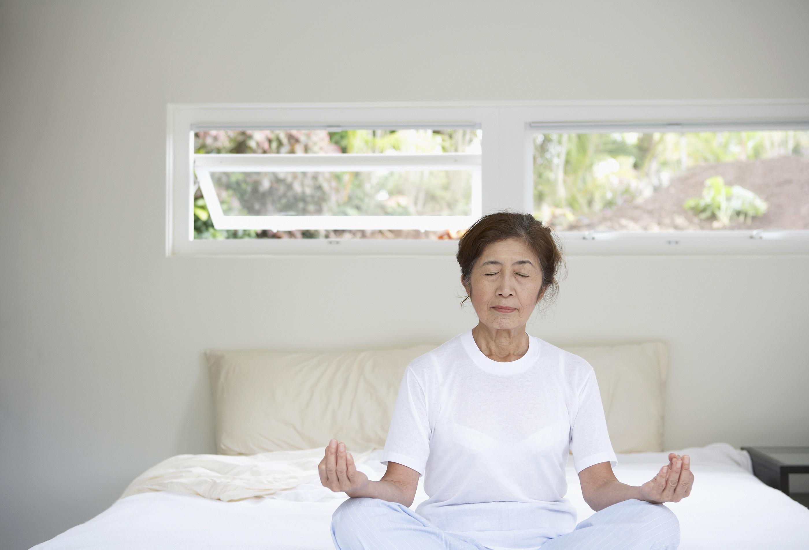 bigstock-Senior-Asian-woman-meditating-73164502