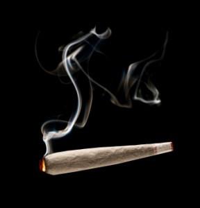 Smoke rises from a marijuana cigarette