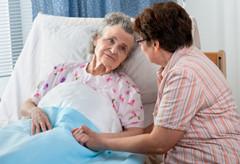 Elderly-woman-in-hospital-bed