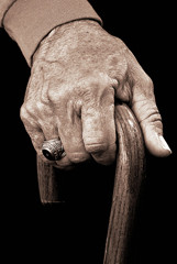 Older-persons-hand-holding-a-cane