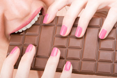 Woman-eating-a-lot-of-chocolate