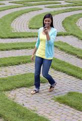 Woman-walking-through-maze