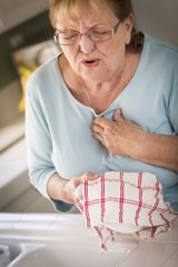 Woman-with-chest-pain