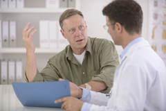 Man-talking-with-doctor