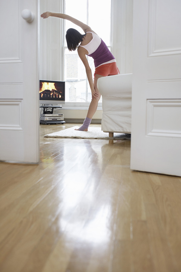 Woman-exercising-in-front-of-TV
