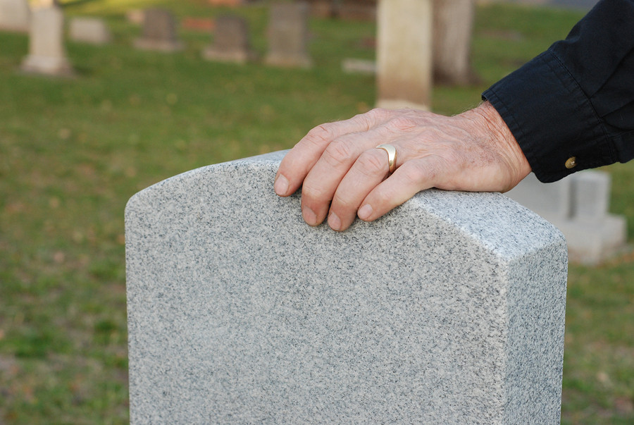 old-Man-s-Hand-Resting-On-Headstone