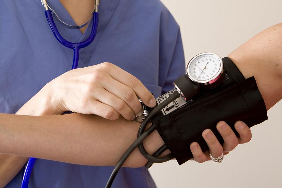 Doctor-or-nurse-taking-a-patieblood-pressure