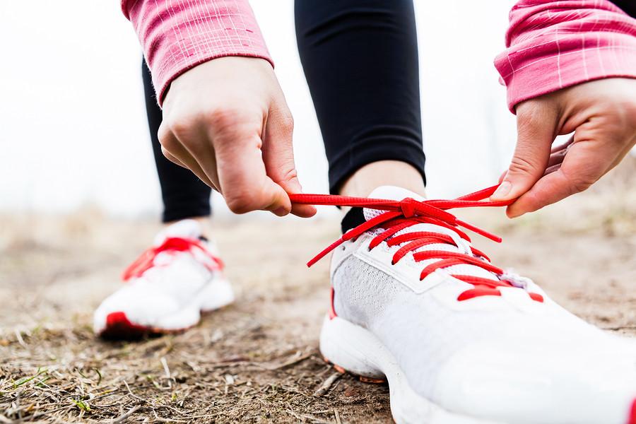 Women-tying-running-shoes
