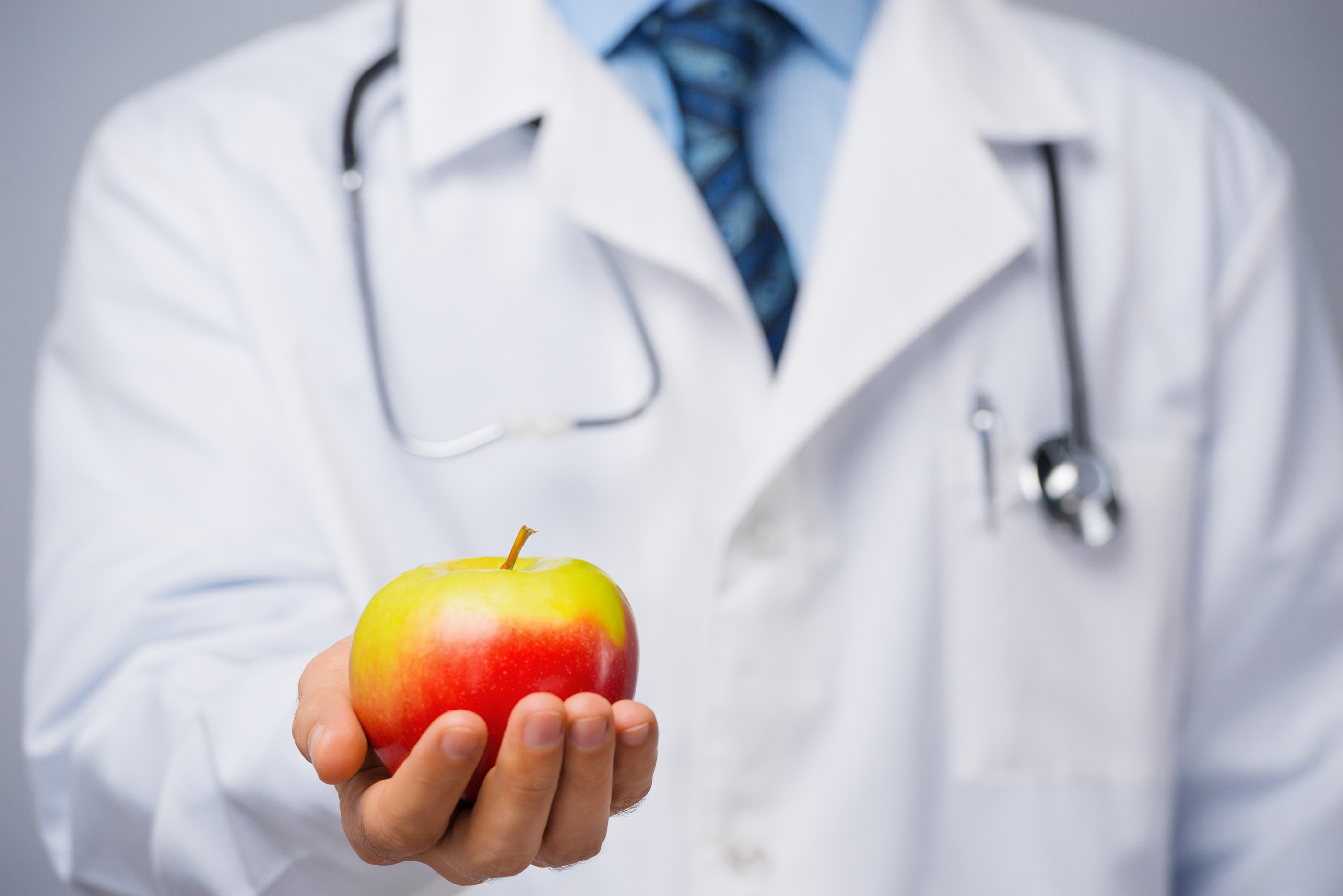 bigstock-Doctor-with-an-apple-74771989