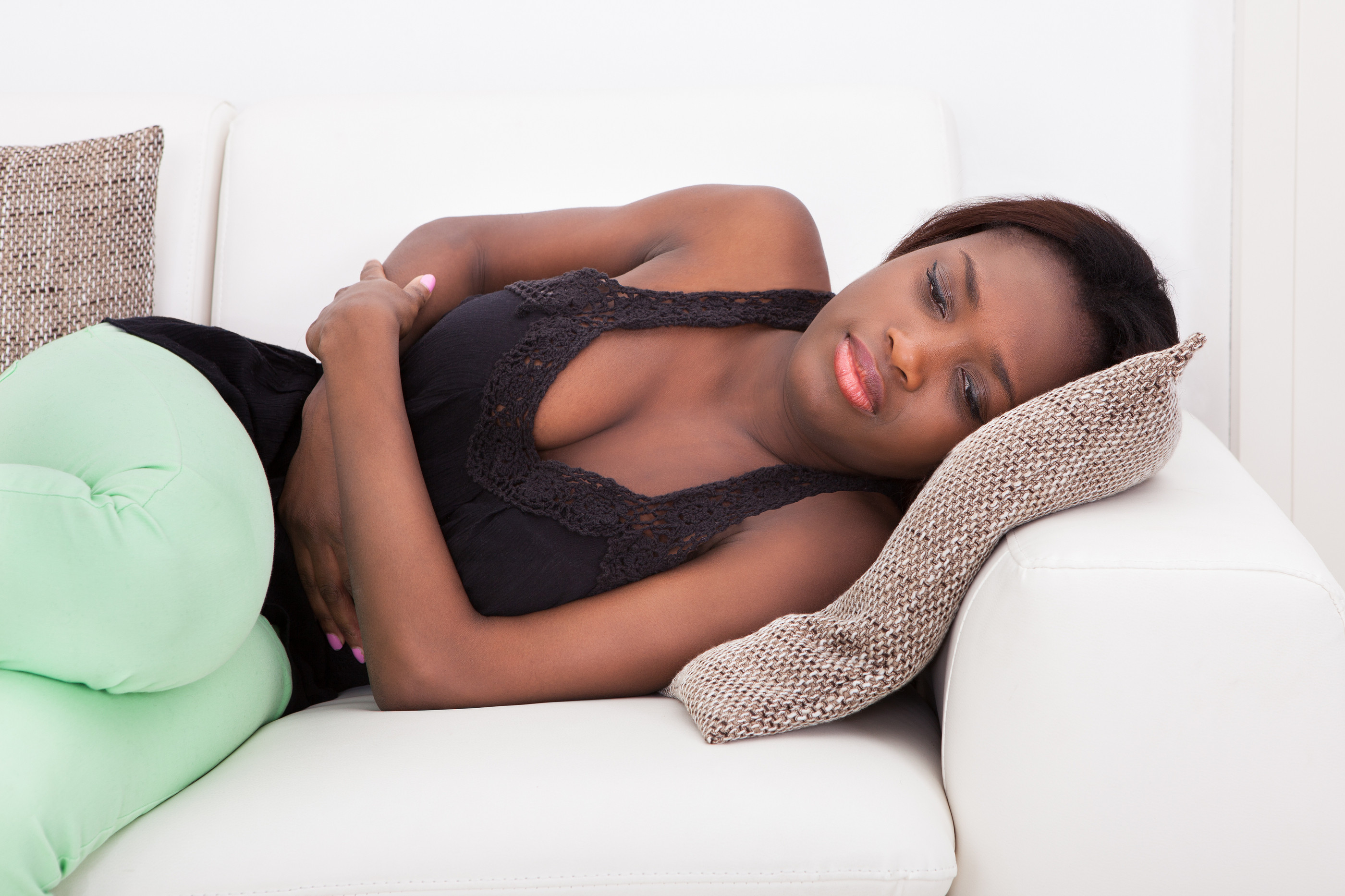 bigstock-Woman-Suffering-stomach-pain-cramps-70891861