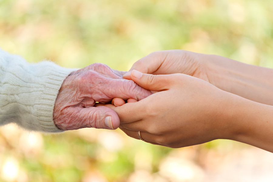 bigstock-Senior-And-Young-Holding-Hands-caregiving