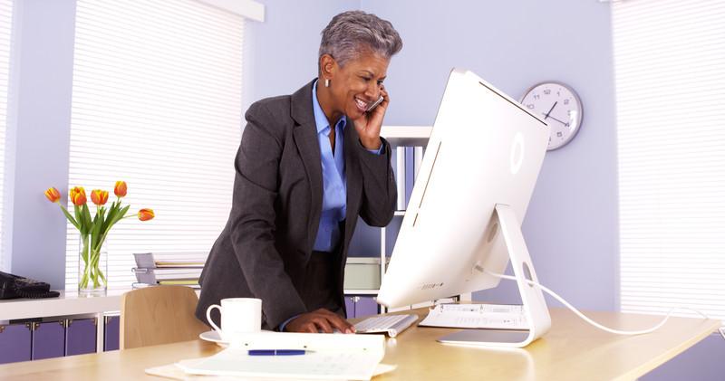women-standing-at-desk
