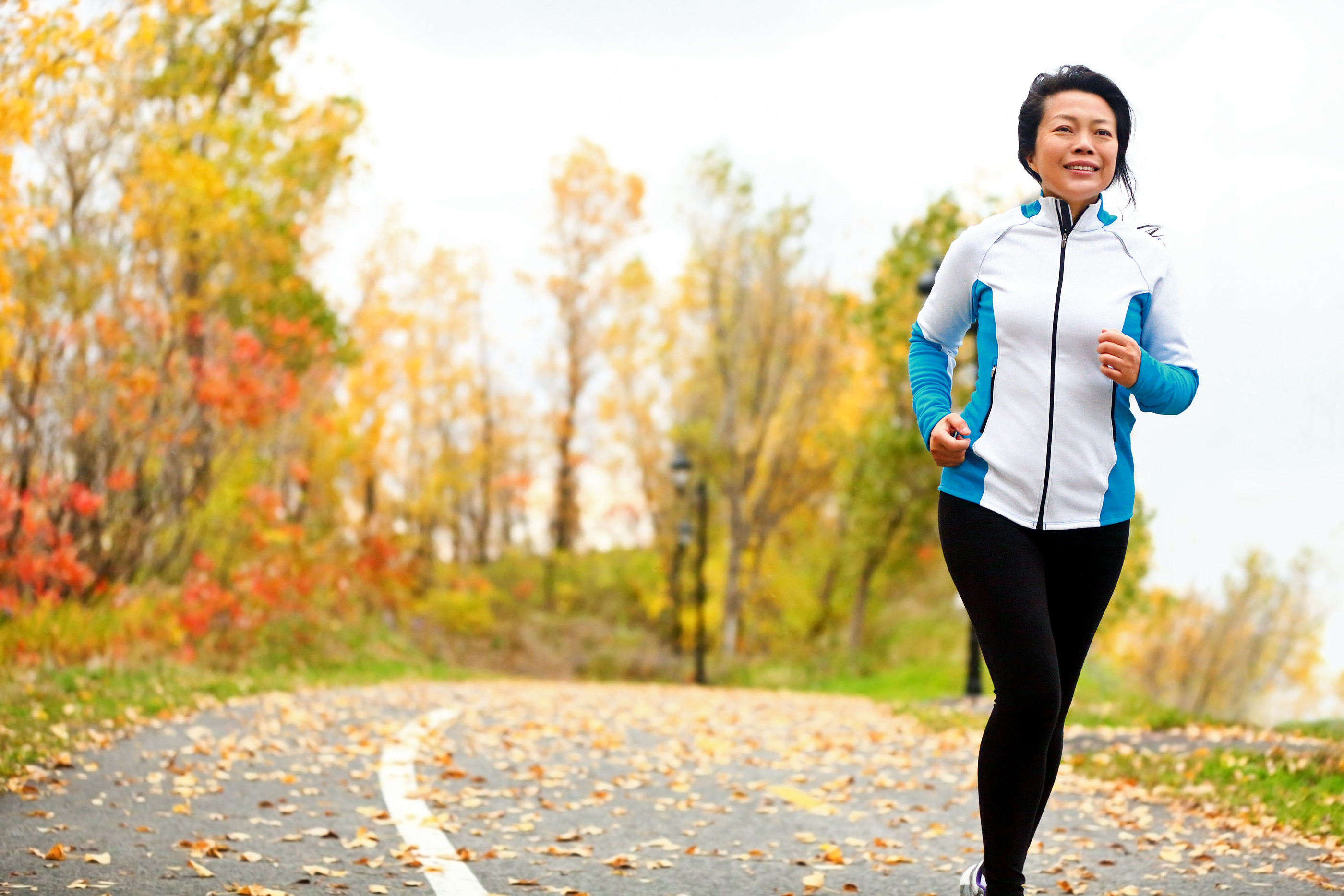 bigstock-Mature-Asian-woman-running-act-48848396