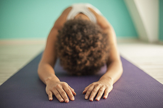 Yoga and meditation offer health care savings—and you can do them at home featured image