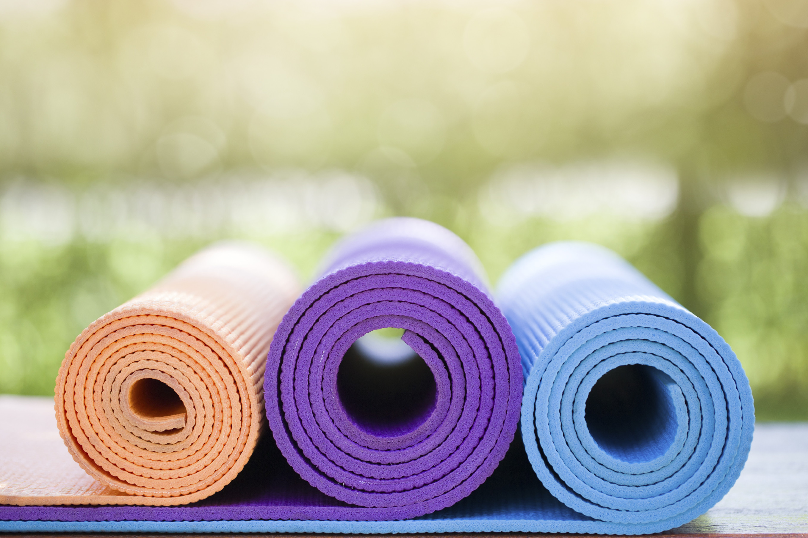 rolled-up-yoga-mats-exercise