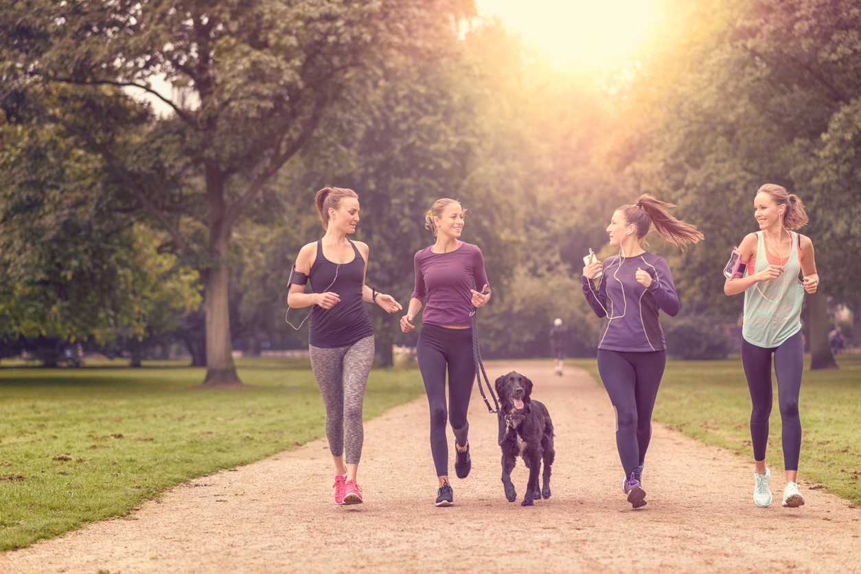 women-running-dog-exercise-cardio-LarsZahnerPhotography-iStock-488120380