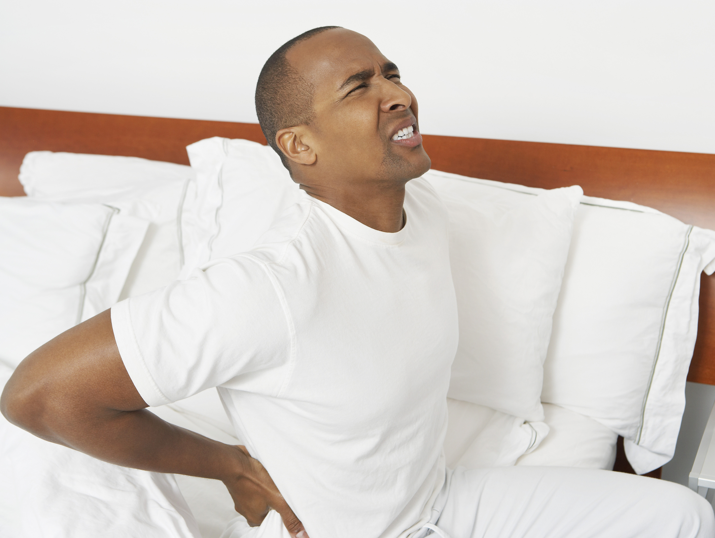 back-pain-bed-man-with-severe-back-pain-bed-41602582