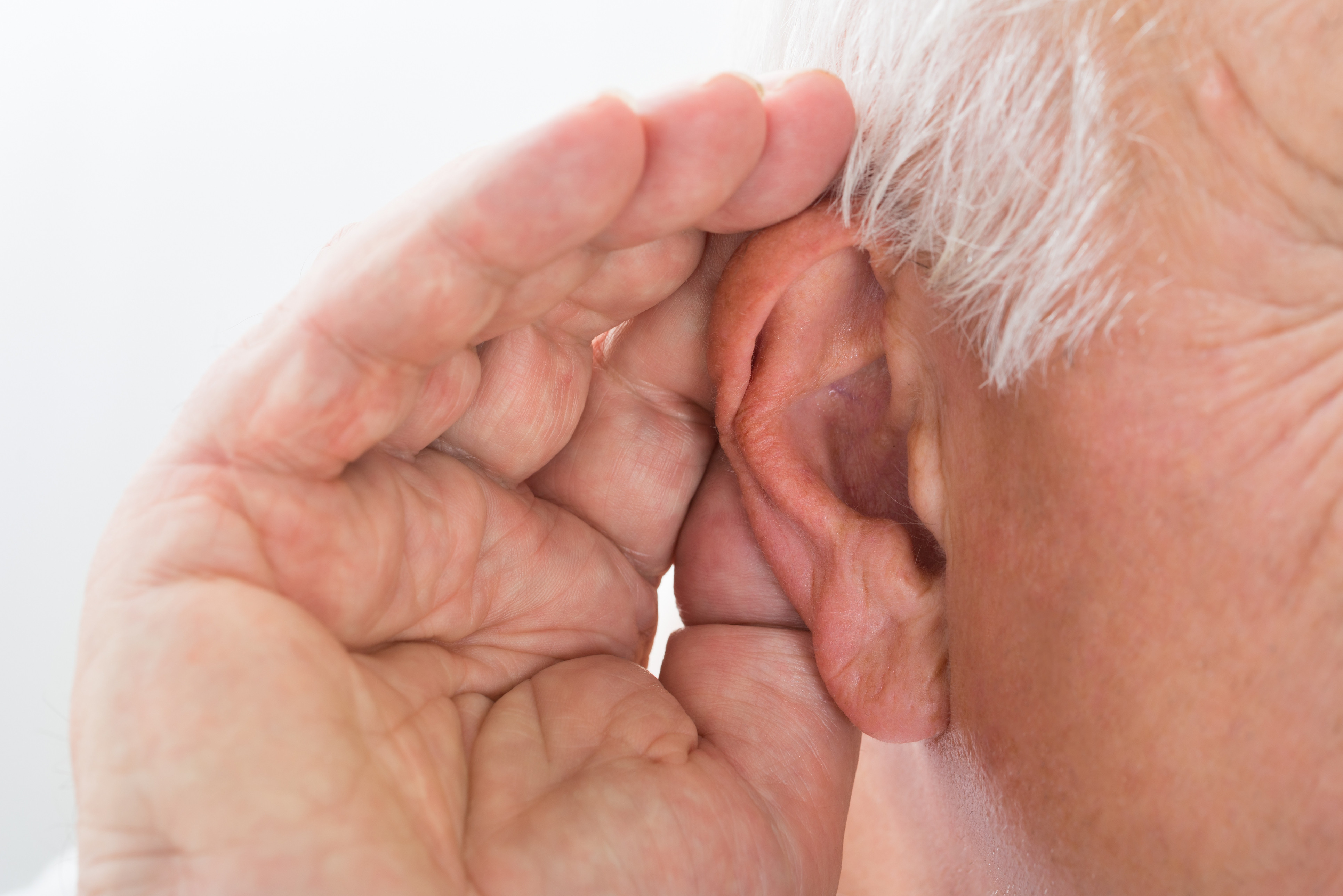 man_cupping_ear_hearing_listening