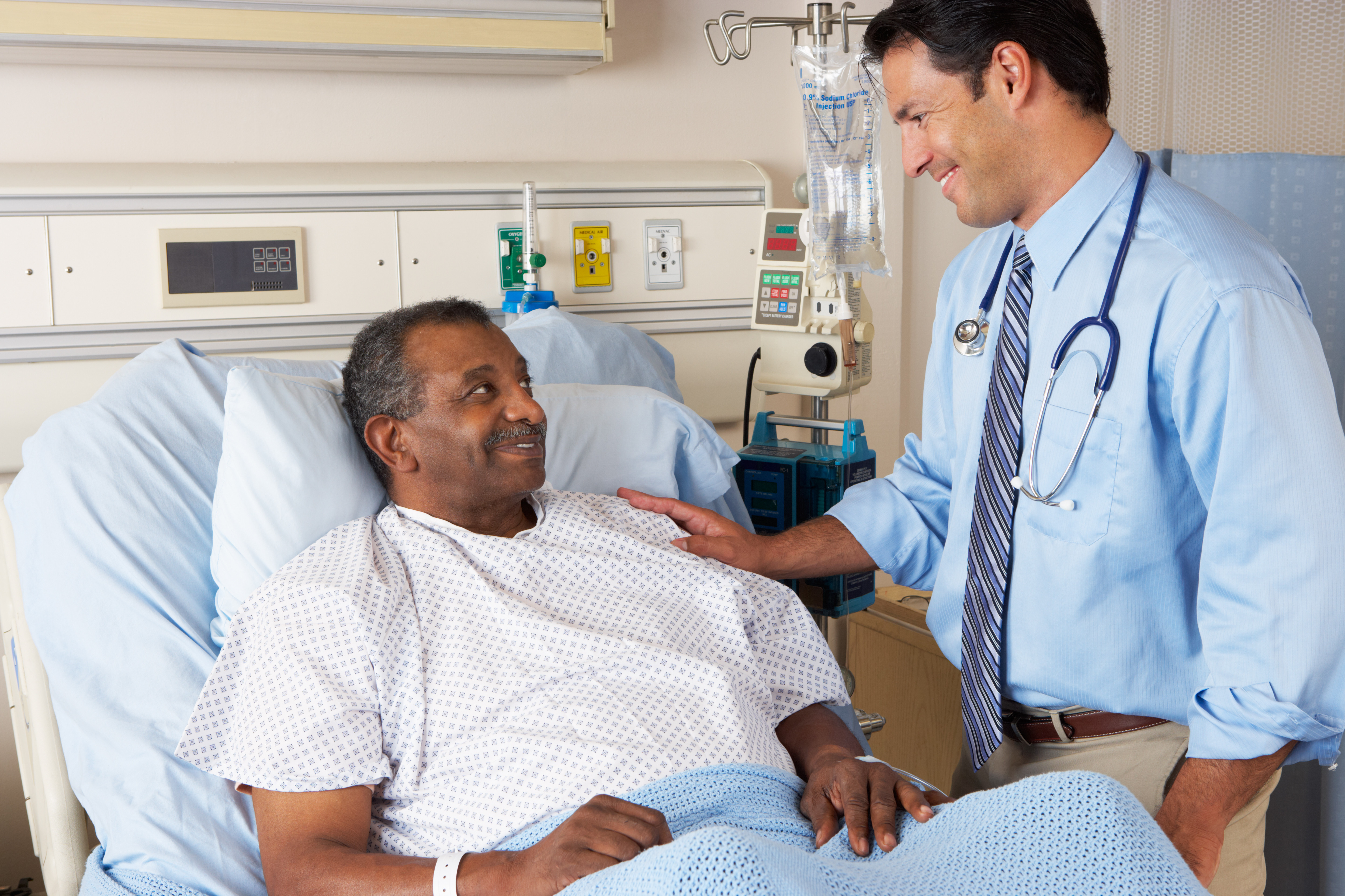 doctor-visiting-black-male-patient-in-hospital-bed