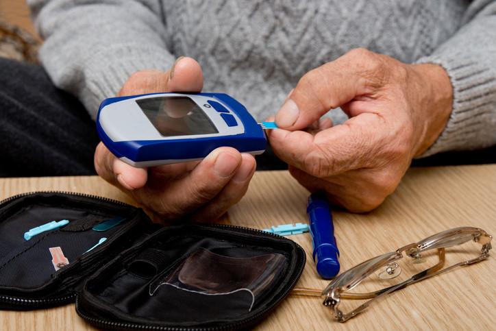older-man-checking-his-blood-sugar