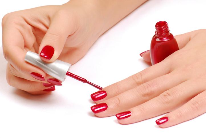 woman-applying-nail-polish