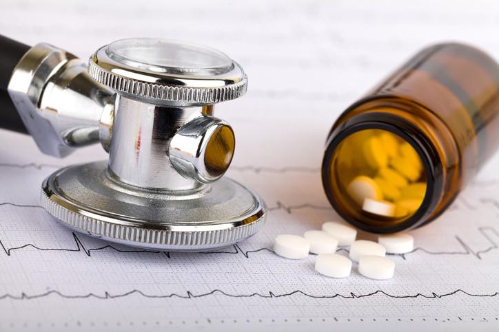 pill-bottle-stethoscope-and-EKG